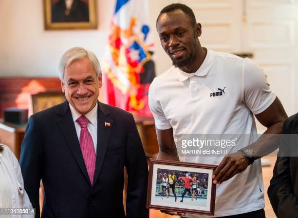 Chilean president Sebastian Pinera and Jamaican eighttime Olympic sprint champion Usain Bolt pose for picture with an altered photograph in which...