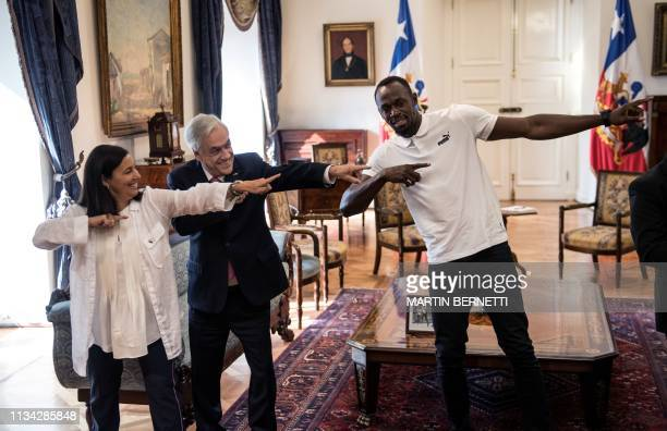 TOPSHOT Chilean President Sebastian Pinera Jamaican eighttime Olympic sprint champion Usain Bolt and Chilean Sport Minister Paulina Kantor pose for...