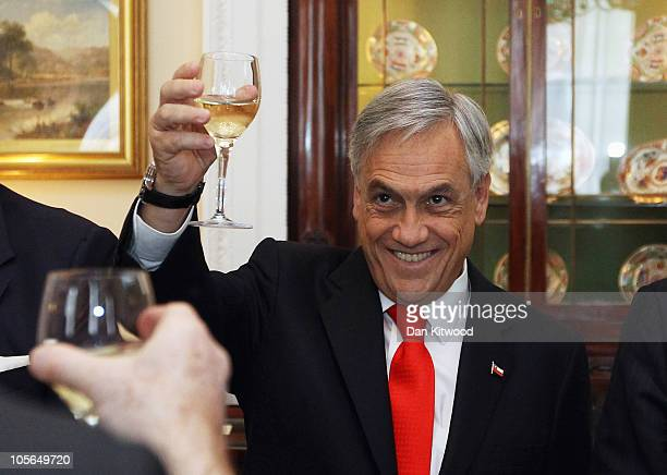 Chilean President Sebastian Pinera raises a toast during luncheon at Mansion House on October 18 2010 in London England Mr Pinera who is currently on...