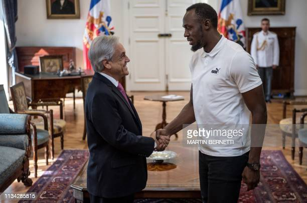 Chilean president Sebastian Pinera shake hands with Jamaican eighttime Olympic sprint champion Usain Bolt during a meeting at La Moneda Presidential...