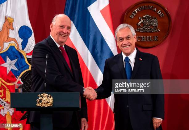 Chilean President Sebastian Pinera shakes hands with King Harald V of Norway during a press conference at La Moneda presidential palace in Santiago...