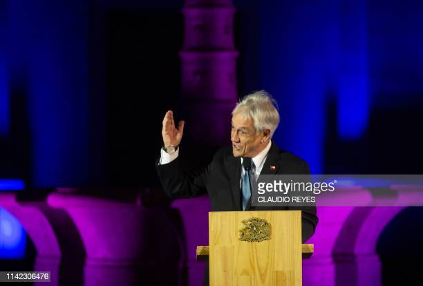 Chilean President Sebastian Pinera speaks during the inauguration ceremony of the Eclipses Season at La Moneda presidential palace in Santiago on May...