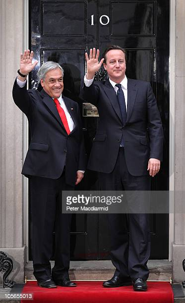 Chilean President Sebastian Pinera stands and waves with British Prime Minister David Cameron in Downing Street on October 18 2010 in London England...