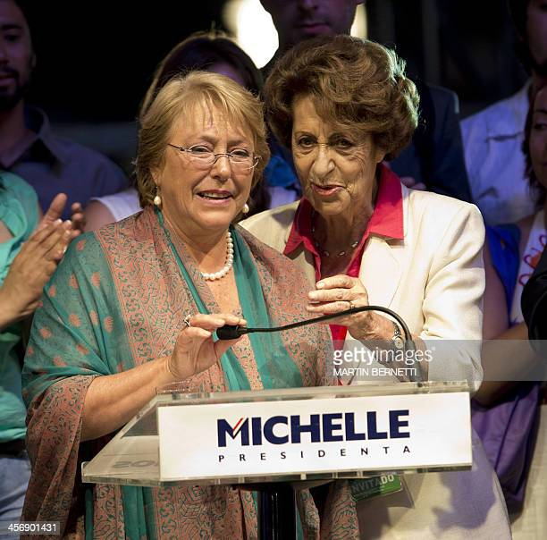 Chilean presidentelect Michelle Bachelet prepares to deliver a speech after getting the results of the runoff presidential election next to her...