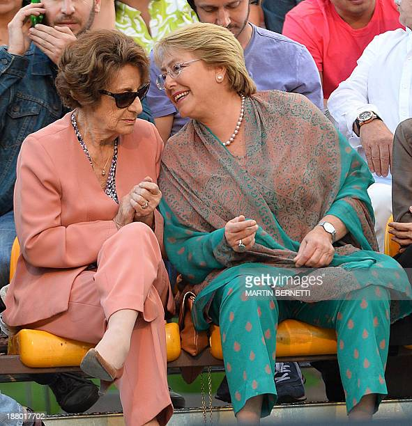 Chilean presidential candidate for the New Majority coalition Michelle Bachelet speak with her mother Angela Jeria during her electoral campaign's...
