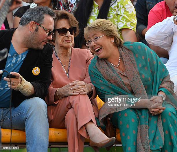Chilean presidential candidate for the New Majority coalition Michelle Bachelet speaks with her mother Angela Jeria and her son Jorge Sebastian...