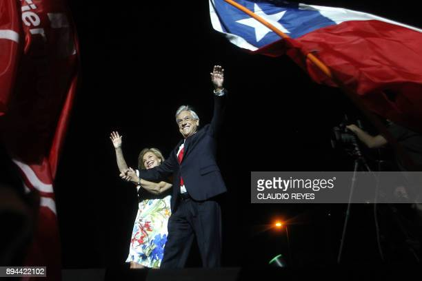 TOPSHOT Chilean presidential candidate Sebastian Pinera and his wife Cecilia Morel celebrate his victory with family and supporters outside a hotel...