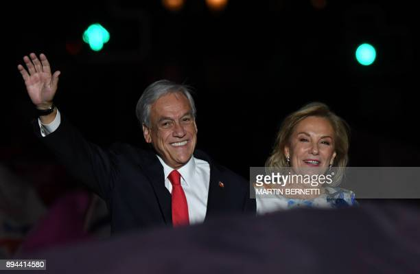 Chilean presidential candidate Sebastian Pinera next to his wife Cecilia Morel publicly celebrates his victory in Santiago after the runoff election...