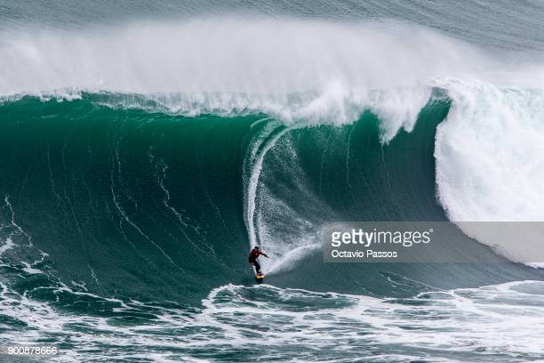 Chilean Rafael Tapia big wave surfer drops a wave during a surf session at Praia do Norte on January 3 2018 in Nazare Portugal