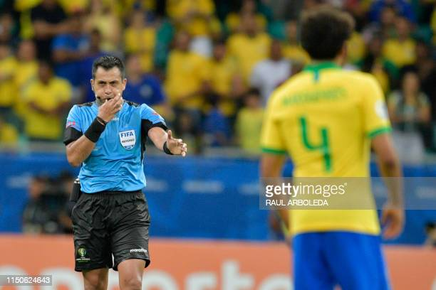 Chilean referee Julio Bascunan blows the final whistle of the Copa America football tournament group match between Brazil and Venezuela at the Fonte...