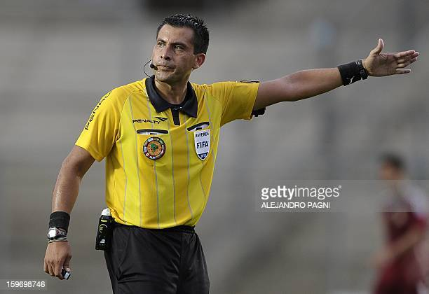 Chilean referee Julio Bascunan gestures during the South American U-20 Championship Group B football match between Venezuela and Uruguay, at...