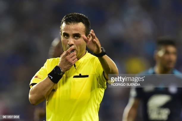 Chilean referee Piero Maza gestures during the Copa Libertadores football match between Ecuador's emelec and Colombia's Santa Fe at George Capwell...