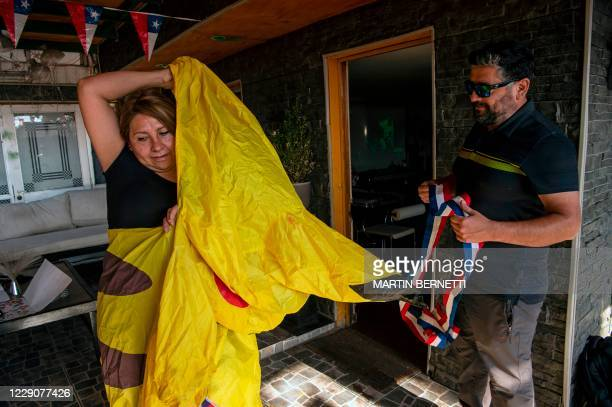 Chilean school bus driver Giovanna Grandon puts on her Pikachu costume -from Japanese series Pokemon- next to her husband Jorge Millan, before...