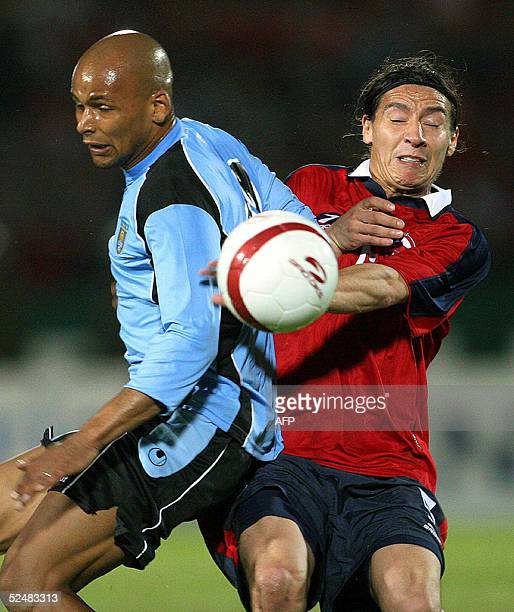 Chilean soccer player Pablo Contreras and Uruguayan Marcelo Zalayeta vie for the ball 26 March 2005 during their FIFA World Cup Germany 2006 South...