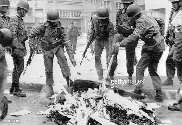 Chilean soldiers burning Marxist books in the capital city during the military coup Santiago 26 September 1973 Presidente Salvador Allende died in...