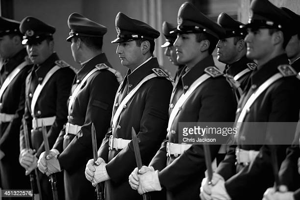 Chilean soldiers form a guard of honour at the La Moneda Presidential Palace on June 27 2014 in Santiago Chile Prince Harry is on a three day tour of...