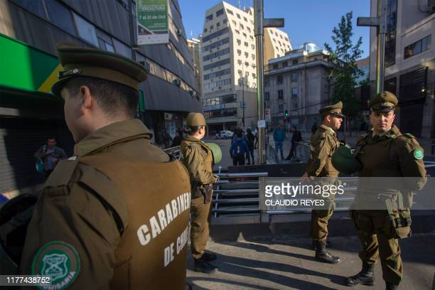 Chilean soldiers stand guard in Santiago Chile on October 21 2019 Violent protests initially against a hike in metro fares first broke out on Friday...