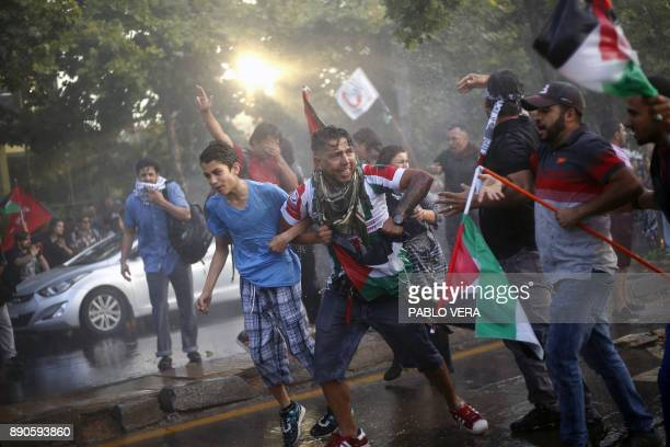 Chilean supporters of Palestine clash with the police during a protest against US President Donald Trump's recognition of Jerusalem as the capital of...