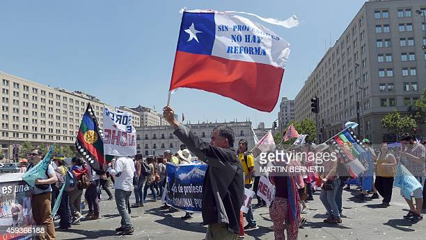 Chilean teachers march in front of La Moneda presidential Palace during a protest against the new education system in Santiago on November 21 2014...
