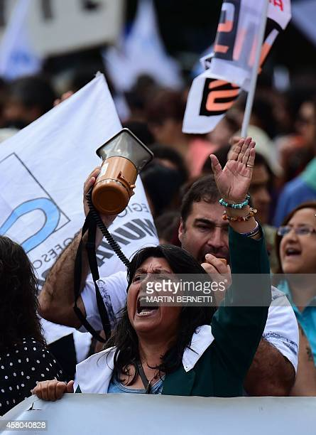 Chilean teachers shout slogans during protest against a new education system in front of La Moneda presidential Palace in Santiago on October 29 2014...