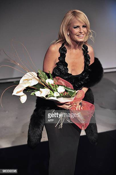 Chilean television entertainer Cecilia Bolocco Miss Universe 1987 and exwife of former Argentine President Carlos Menem poses for the press upon her...