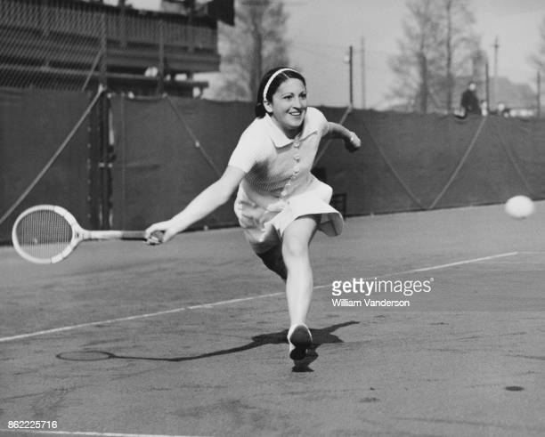 Chilean tennis player Anita Lizana in action against R E Haylock during the Women's Singles final of the Tally Ho Lawn Tennis Tournament in...