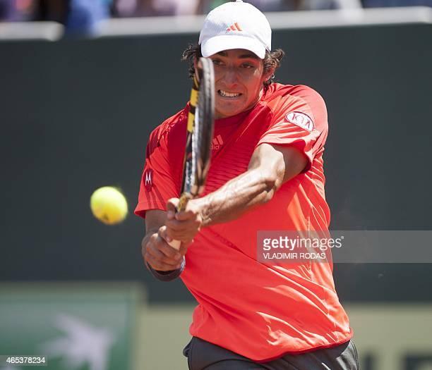 Chilean tennis player Christian Garin returns de ball during his Davis Cup Americas Zone Group II match against Peruvian player Duilio Beretta held...