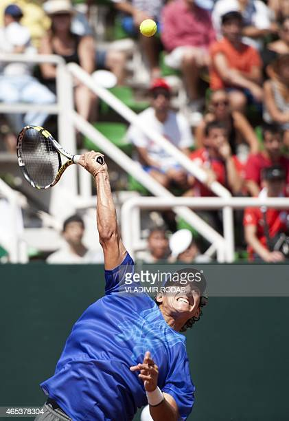 Chilean tennis player Christian Garin serves to Peruvian Duilio Beretta during the first round of the Davis Cup Americas Zone Group II in Santiago on...