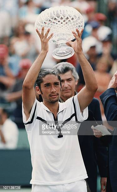 Chilean tennis player Marcelo Rios with the trophy after he beat Andre Agassi in the final of the Lipton International Players Championships , Key...