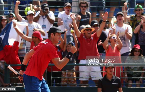 Chilean tennis player Nicolas Jarry celebrates after defeating Ecuadorean player Roberto Quiroz during their Davis Cup singles tennis match at the...