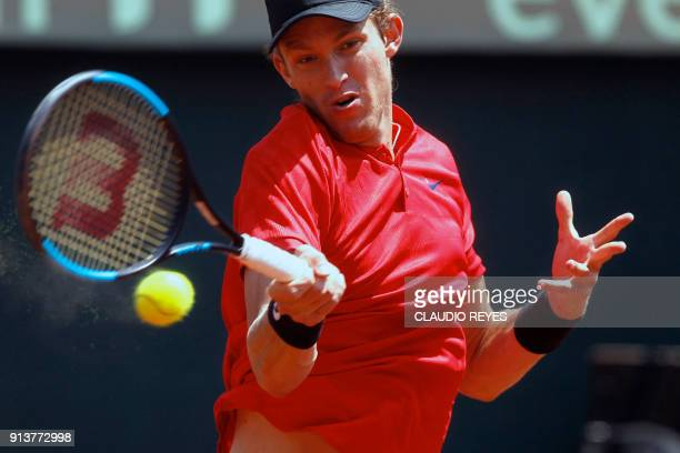 Chilean tennis player Nicolas Jarry returns the ball to Ecuadorean player Roberto Quiroz during their Davis Cup singles tennis match at the National...