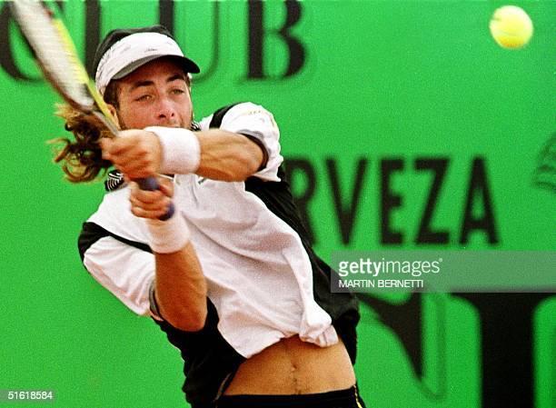 Chilean tennis player Nicolas Massu hits the ball 12 September 1999 in Quito El tenista chileno Nicolas Massu golpea la pelota en la final del torneo...
