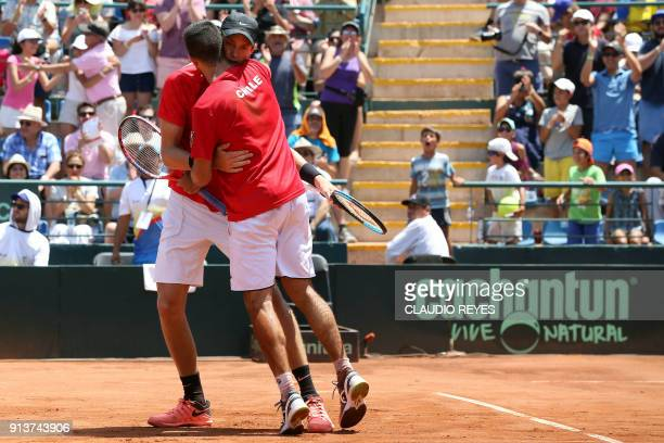 Chilean tennis players Nicolas Jarry and Hans Podlipnik celebrate after winning their Davis Cup doubles tennis match against Ecuadorean players...