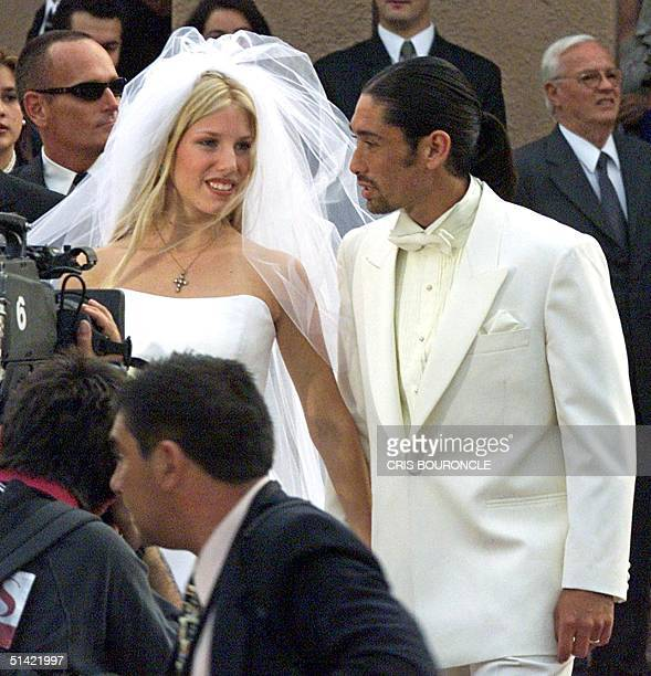 Chilean tennis star Marcelo Rios and his 17yearold bride Giuliana Sotela leave the Santa Ursula church in Santiago Chile after their wedding ceremony...