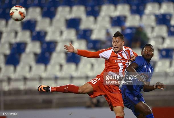 Chilean Universidad Catolica's footballer Nicolas Castillo vies for the ball with Gabriel Achilier of Ecuadorean Emelec during their Copa...