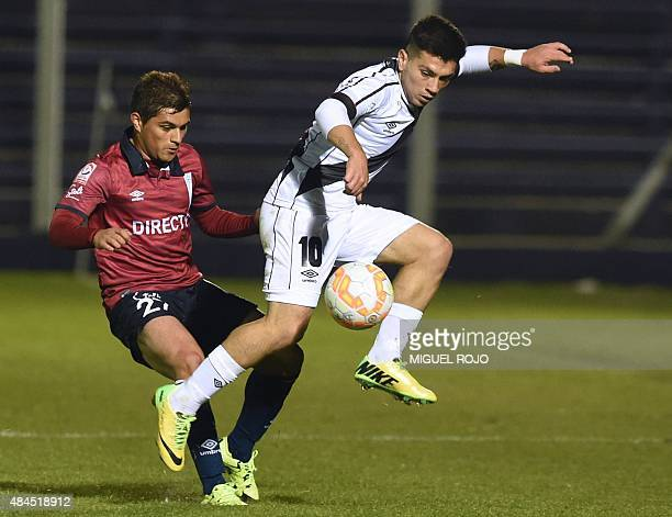 Chilean Universidad Catolica's Juan Espinoza vies for the ball with Uruguay's Danubio's Ignacio Gonzalez during their Copa Sudamericana football...