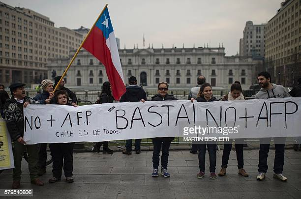 Chilean workers march to protest against the Pension Fund Administrator in front of the La Moneda presidential palace in Santiago on July 24 2016...