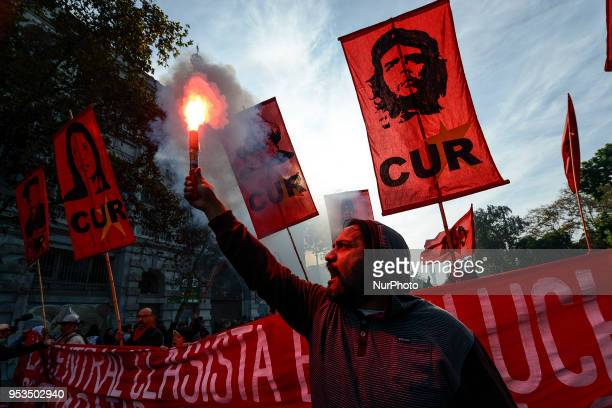 Chilean workers take part in a May Day march in Santiago on May 1 2018 Demonstrators clash with riot police during a march to mark International...
