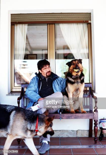 Chilean writer Luis Sepulveda with two dogs Gijon 11th April 2003