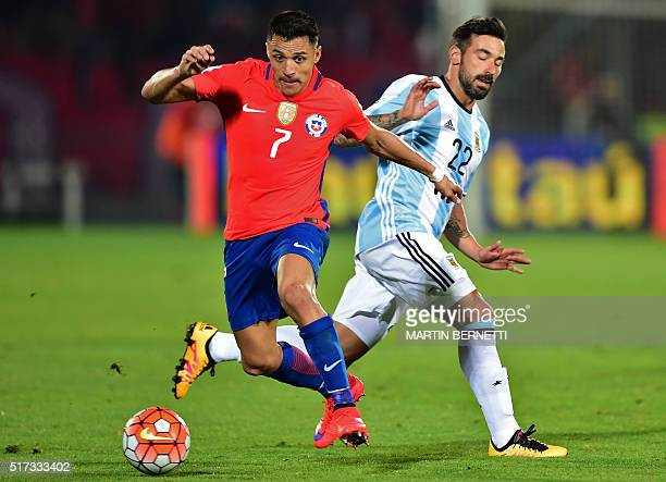Chile's Alexis Sanchez and Argentina's Ezequiel Lavezzi vie for the ball during their Russia 2018 FIFA World Cup South American Qualifiers' football...