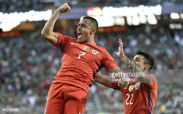Chile's Alexis Sanchez celebartes a goal against Mexico with teammate Edson Puch during the Copa America Centenario quarterfinal football match in...