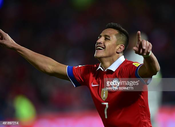 Chile's Alexis Sanchez celebrates after scoring against Brazil during their Russia 2018 FIFA World Cup qualifiers match at the Nacional stadium in...