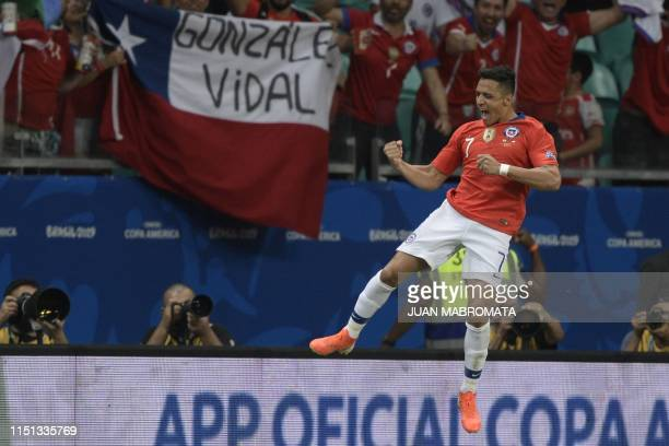 TOPSHOT Chile's Alexis Sanchez celebrates after scoring against Ecuador during their Copa America football tournament group match at the Fonte Nova...