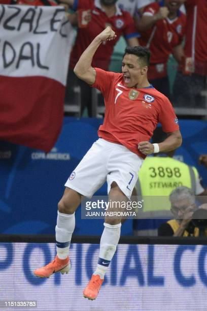 Chile's Alexis Sanchez celebrates after scoring against Ecuador during their Copa America football tournament group match at the Fonte Nova Arena in...