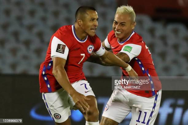 Chile's Alexis Sanchez celebrates with teammate Eduardo Vargas after scoring against Uruguay during their 2022 FIFA World Cup South American...