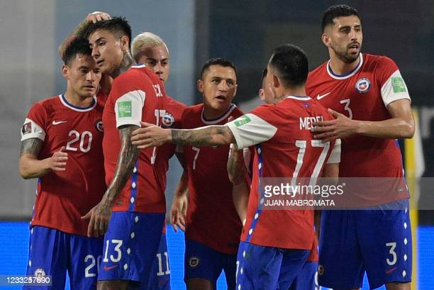Chile's Alexis Sanchez celebrates with teammates after scoring against Argentina during their South American qualification football match for the...