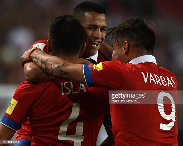 Chile's Alexis Sanchez celebrates with teammates after scoring against Peru during their Russia 2018 FIFA World Cup South American Qualifiers...