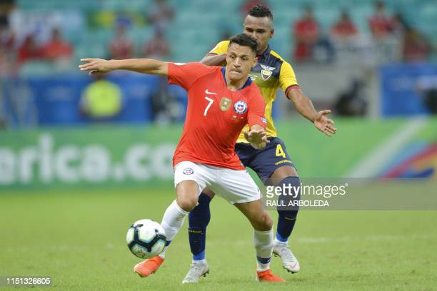 TOPSHOT Chile's Alexis Sanchez is marked by Ecuador's Pedro Pablo Velasco during their Copa America football tournament group match at the Fonte Nova...