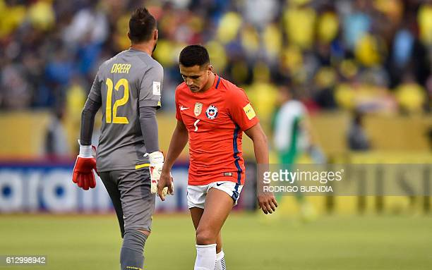 Chile's Alexis Sanchez leaves the field in dejection after the Russia 2018 World Cup football qualifier match in Quito on October 6 2016 Ecuador won...