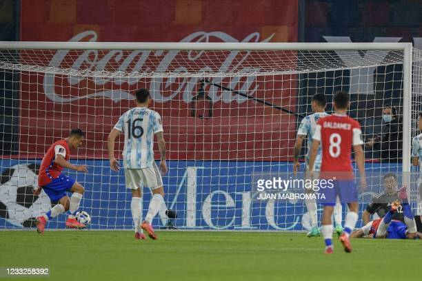 Chile's Alexis Sanchez scores against Argentina during their South American qualification football match for the FIFA World Cup Qatar 2022 at the...